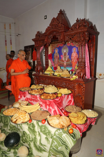 An annakut of sweets, savouries and fruit and vegetables is offered to the Lord