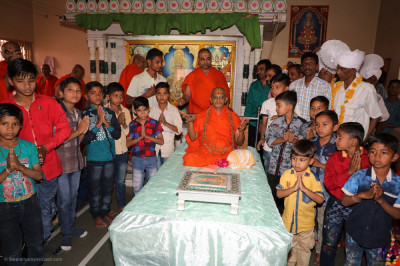 His Divine Holiness Acharya Swamishree blesses all the children