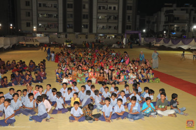 School children and disciples gather in the huge ground