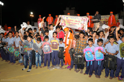 His Divine Holiness Acharya Swamishree donates school bags to all children