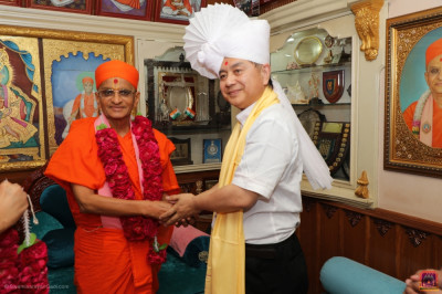 His Divine Holiness Acharya Swamishree blesses Mr. Kodama