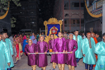 Disciples who have sponsored the celebrations pull the golden chariot
