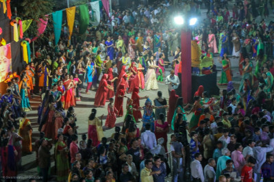 Thousands of disciples take part in the raas and devotional dance competitions