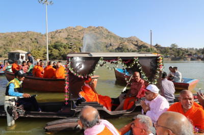 His Divine Holiness Acharya Swamishree, sants and disciples on boats on Lake Nakhi