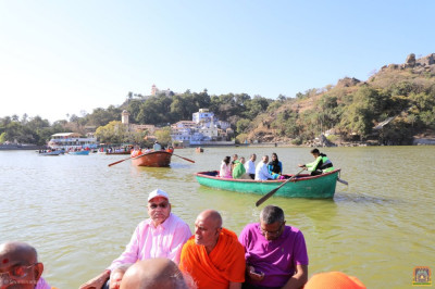 Sants and disciples in boats at Lake Nakhi