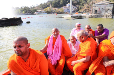 Sants and disciples in a boat at Lake Nakhi