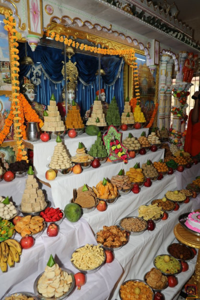 Sants and disciples prepare an abundant variety of sweet and savoury items in the form of annakut to offer to the Lord