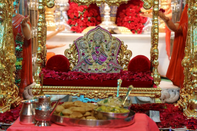 Divine darshan of Shree Harikrishna Maharaj dining on delicious traditional savoury and sweet items