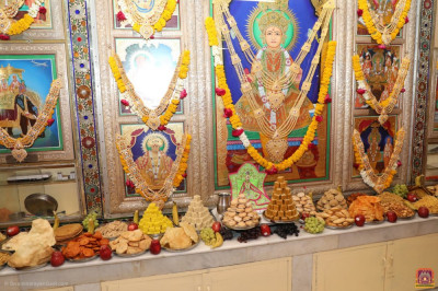 An annakut of sweet and savoury items is offered to the Lord