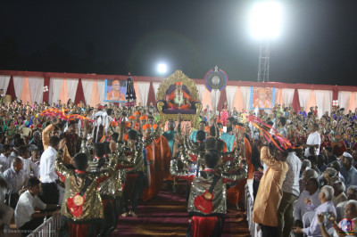 Disciples perform devotional dances as His Divine Holiness Acharya Swamishree Maharaj enters the grand venue