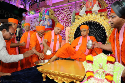 Sants and disciples bathe the divine lotus foot of His Divine Holiness Acharya Swamishree Maharaj in the five nectars