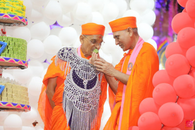 Sants offer His Divine Holiness Acharya Swamishree Indian sweets