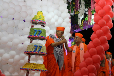 Sants offer His Divine Holiness Acharya Swamishree Maharaj Indian sweets