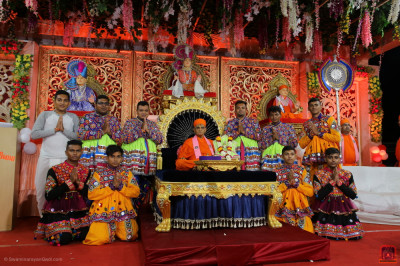 His Divine Holiness Acharya Swamishree Maharaj blesses disciples who performed during the evening