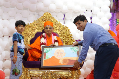 His Divine Holiness Acharya Swamishree Maharaj blesses disciples who present the hand drawn and painted portrait