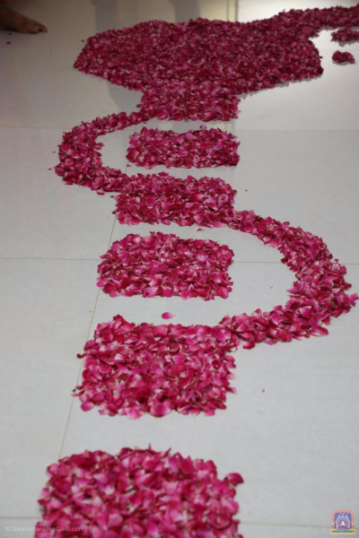 Fresh red and pink flower petals are arranged to form a walkway