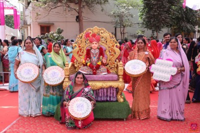 Disciples who have sponsored the scripture recitals of Shree Swaminarayan Gadi Granth carry gifts to please Lord Shree Swaminarayanbapa Swamibapa