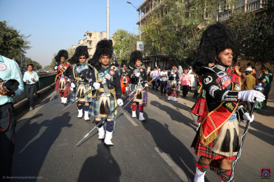 All five parts of Shree Muktajeevan Swamibapa Pipe Band perform during the morning procession