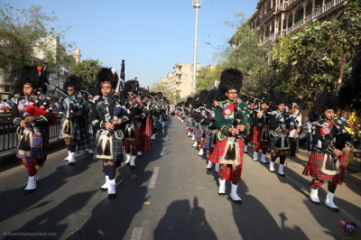 Shree Muktajeevan Swamibapa Pipe Band perform and march in unison during the morning procession