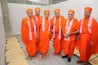 His Divine Holiness Acharya Swamishree Maharaj blesses sants who are responsible for organising the preparation of food items during the grand celebrations