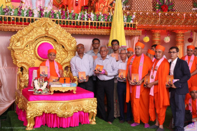 Acharya Swamishree Maharaj blesses sants and disciples who have helped and sponsored  the new publication called Nandratna Part 2 containing revived devotional songs written by 'Nand Padvi' sants