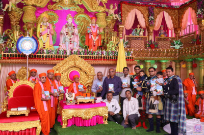 Acharya Swamishree Maharaj blesses sants and disciples who have helped and sponsored the new publication titled Vachan Sudhha