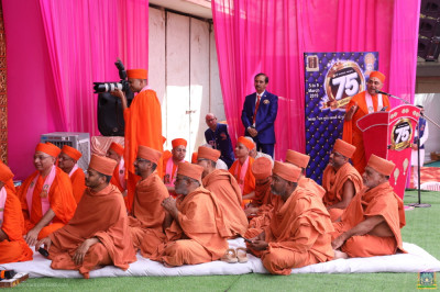 Sants of the Haridham Sokhda Akshar Purushottam Sansthan seated on the grand stage