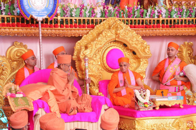 His Divine Holiness Acharya Swamishree Maharaj and Hariprasdji Maharaj warmly greet each other