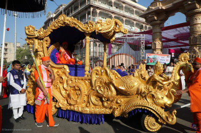 A side view of the magnificent golden chariot glistening in the brilliant sunshine