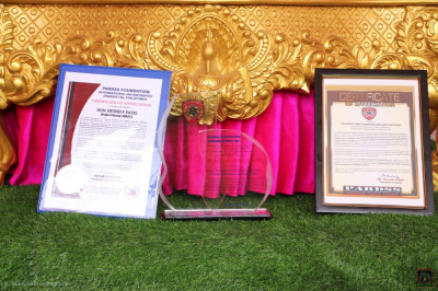 The award and two certificates presented to His Divine Holiness Acharya Swamishree Maharaj by PARDSS