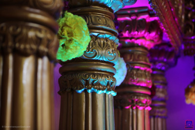 The opulent golden columns lit with coloured lights form part of the grand stage