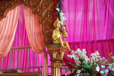 The Lord seated on one of the golden columns on stage