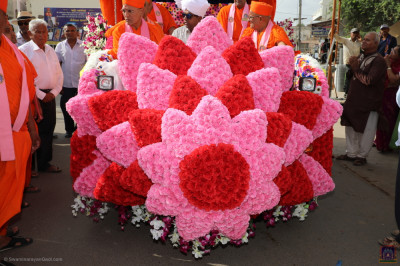 The grand float decorated with pink and red flower petals