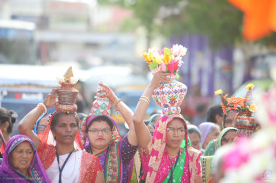 Disciples carry karash throughout the grand procession