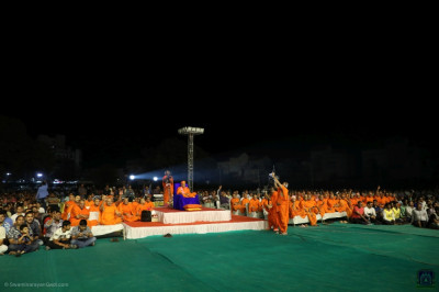 His Divine Holiness Acharya Swamishree Maharaj, sants, and thousands of disciples from around the world enjoy the international performances of Satsang Rangat
