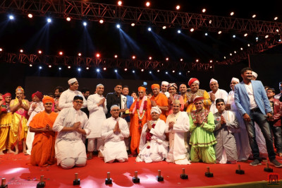 In second place, disciples from Bolton.  His Divine Holiness Acharya Swamishree Maharaj presents the trophy on stage.