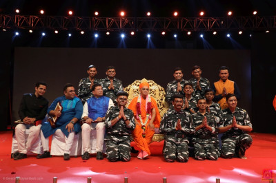 His Divine Holiness Acharya Swamishree Maharaj blesses the students and disciples who took part in the patriotic soldier dance