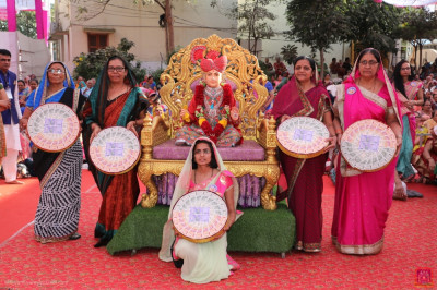Disciples who have sponsored the scripture recital of 'Shree Swaminarayan Gadi Granth' cary gifts for the Lord