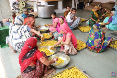 Disciples prepare afternoon prasad lunch