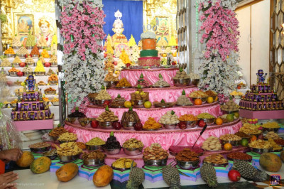 Divine darshan of the Lord dining on the grand annakut of sweet and savoury items
