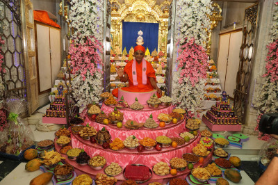 His Divine Holiness Acharya Swamishree Maharaj blesses all surrounded by the magnificent annakut of sweet and savoury items