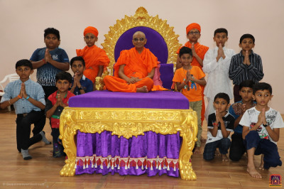 His Divine Holiness Acharya Swamishree Maharaj blesses young disciples who performed a devotional drama to please the Lord