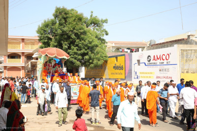 Sants and disciples fill the village streets