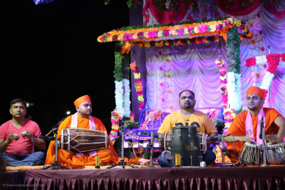 Sants and talented musicians perform devotional songs as part of the evening devotional programme to please the Lord
