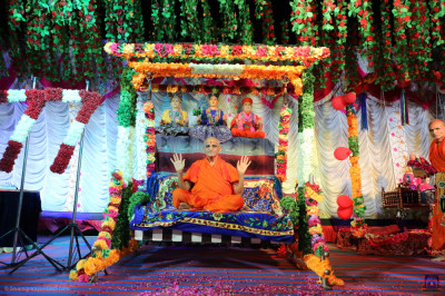 His Divine Holiness Acharya Swamishree Maharaj blesses all seated on the charming swing