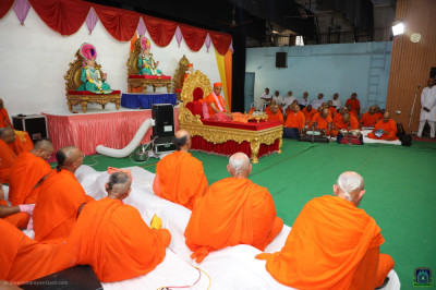 His Divine Holiness Acharya Swamishree Maharaj and sants seated on the grand stage