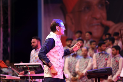 An orchestra of over 60 performers deliver live devotional songs