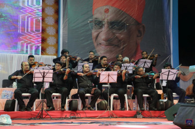 The strings section perform during the devotional concert