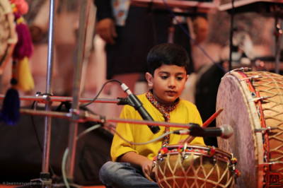 A young performer performs during the devotional concert