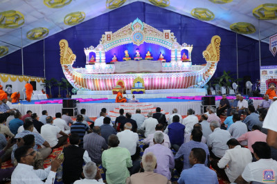 Hundreds of disciples from around the world gather and take part in the maha poojan ceremony before the start of the divine scripture recitals